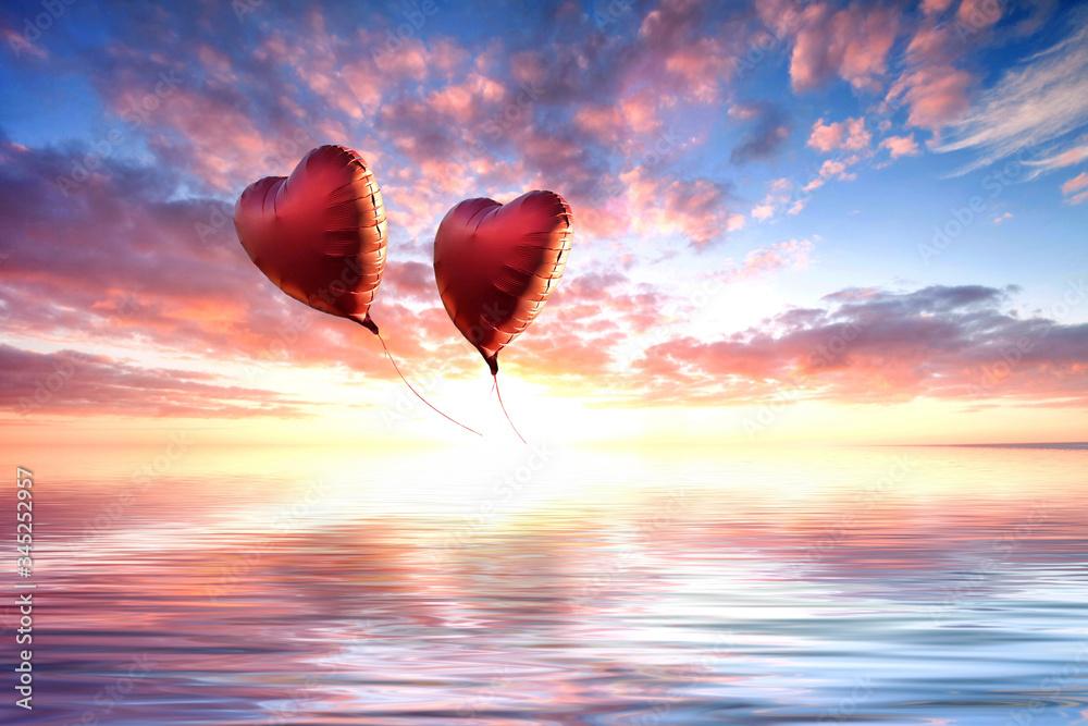 Fototapeta rote Luftballons fliegen in den Sonnenuntergang,