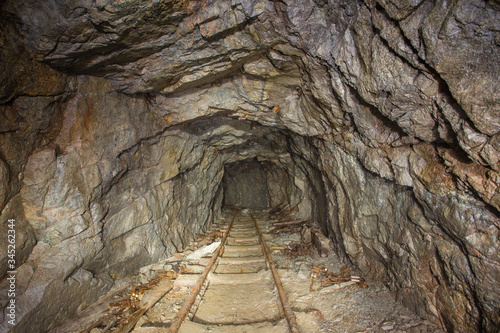 Underground abandoned iron ore mine tunnel with rails Slika na platnu