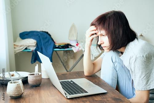 Digital addiction, woman in panic reads articles about coronavirus on Internet Canvas Print