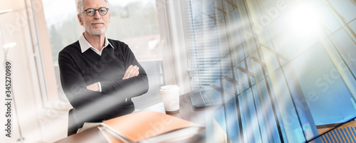 Photo Portrait of businessman with arms crossed; multiple exposure
