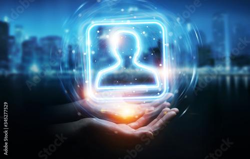 Fototapeta Man hand using digital blue holographic user interface 3D rendering obraz
