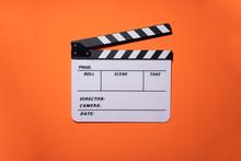 Movie Clapper On Orange Table ...