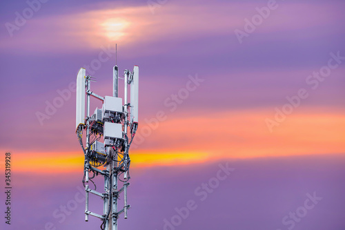 Antenna and Transceiver 5G, 4G on sunset background. Canvas Print
