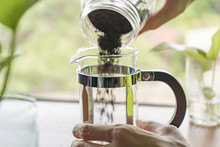 Pouring Ground Coffee Into The French Press Coffee Maker