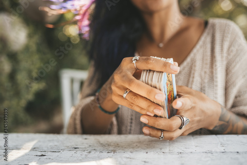 Close uo of female hands with Tarot cards Fotobehang