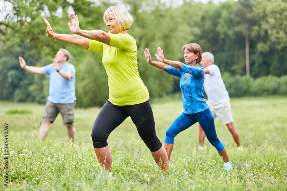 Fototapeta Seniors in the wellness class are doing Qi Gong