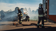 Rescue Team Of Firefighters Ar...