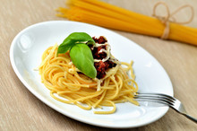 Detail Of Spaghetti Bolognese With Parmesan Cheese And Basil. Italian Traditional Pasta Meal.