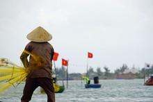 Vietnamese Fisherman Fishing With Net