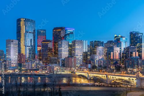 Fototapeta View of Calgary's beautiful skyline at night along the Bow River.  obraz na płótnie