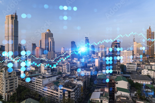 Fototapeta Day time view cityscape of Bangkok city background with business chart grid. Success and finance concept. Doublexposure