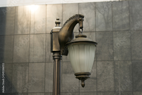 Unusual street lamp forged in the shape of a horse's head Canvas-taulu