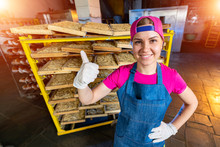 Woman Worker On Recks With Macaroni Background. Ok Sign. Happy Employee At Work.