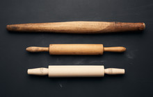 Three Types Of Wooden Rolling Pins For Rolling Dough On A Black Background