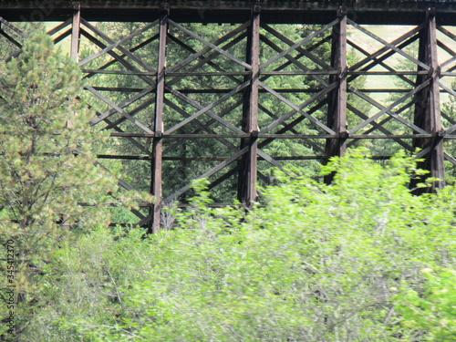 Vászonkép Old wooden train wooden trestle