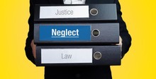 Neglect – Lawyer Carries A Stack Of 3 File Folders. One Folder Has The Label Neglect. Symbol For Law, Justice, Judgement