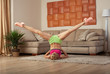 young blonde sporty fit woman doing gymnastic and yoga exercis at home training