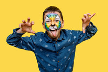 Little Boy With Tiger Faceart Or Aquagrim Posing Isolated On Yellow Background