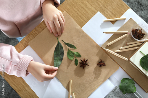 Fototapeta Little girl working with natural materials at table, top view. Creative hobby obraz