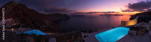 Santorini sunset panoramic overlooking cliffside infinity pool.