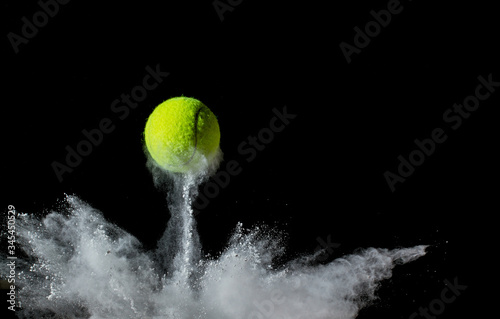 Fotografie, Obraz tennis ball on black background