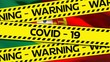 Animation of the words Covid-19 and Warning written on yellow tape over a Portugese flag in the back