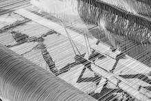 Grayscale Shot Of Carpet Weavi...
