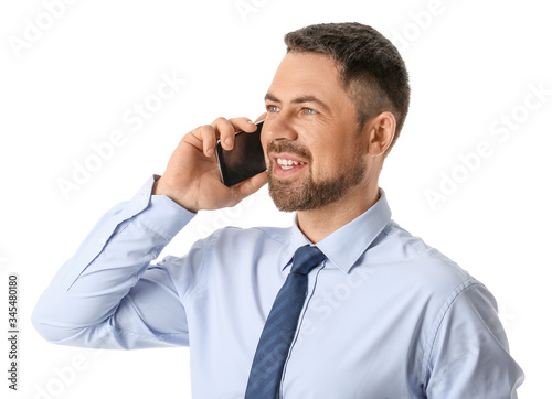 Photo Portrait of handsome businessman talking by mobile phone on white background