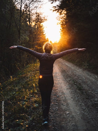 Fototapety, obrazy: Happy woman raised her arms up and enjoy the sunset in the forest