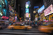 Leinwandbild Motiv People Walking On Road At Night