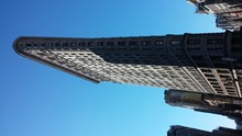 Low Angle View Of Flatiron Building Against Clear Blue Sky On Sunny Day