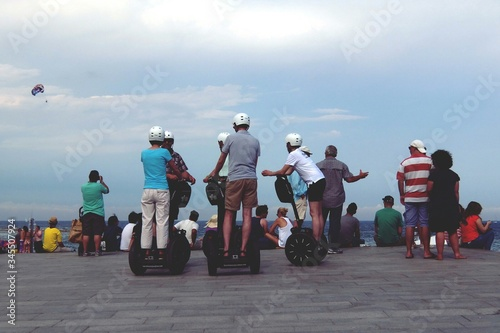 Obraz Rear View Of People On Segways At Beach - fototapety do salonu