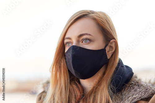 Papel de parede health, safety and pandemic concept - young woman wearing black face protective