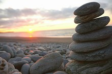 Stack Of Pebbles On Beach Agai...