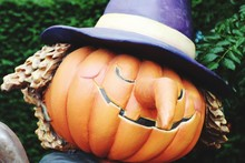 Close-up Of Artificial Pumpkin With Purple Hat