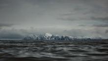 Snowy Mountains Across The Sea...