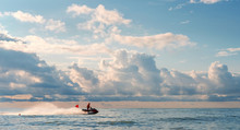 The Water Rescuer Patrols Sea Shore On A Jet Ski