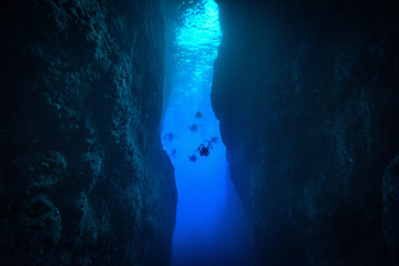 Person Scuba Diving At Deep Sea