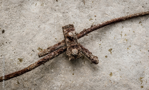 Fotografering Antique rusty metal wire connector with stone background