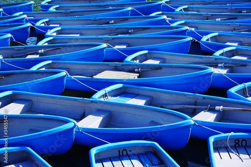 Fotomural Blue Rowboats In Sea