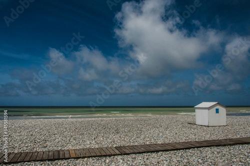 Fotografie, Obraz Beach Hut On Beach Against Cloudy Sky