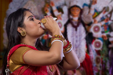 """""""Portrait Of A Beautiful Bengali Woman Blowing Conch Shell At Durga Puja"""""""