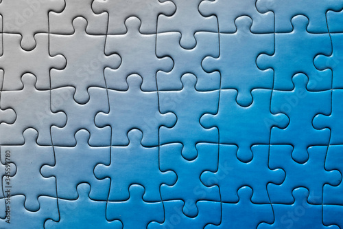 Valokuvatapetti Blue pieces puzzle degraded from right to left