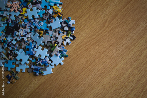 Valokuva Close -up puzzle pieces piled up on a wooden table