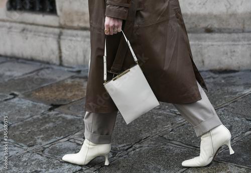 Fototapeta Street style accessories – White leather high heel boots and handbag  – StreetStyleFW2020 obraz