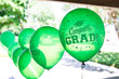 canvas print picture - Close-up of Green Helium-filled graduation party balloons with Congrats Grad message in an outdoor setting