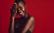 Smiling african woman wearing vivid makeup