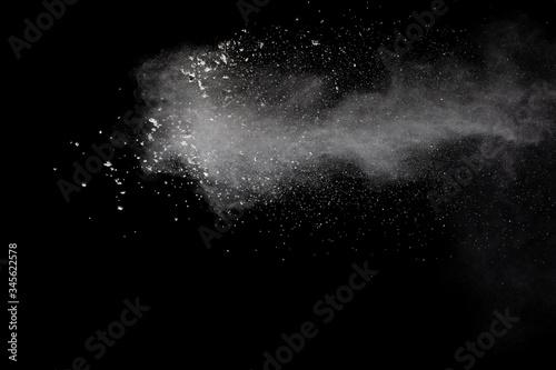 Cuadros en Lienzo Freeze motion of white dust particles splash on black background