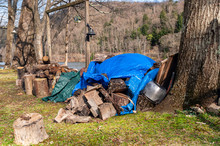 A Pile Of Partially Covered Cu...