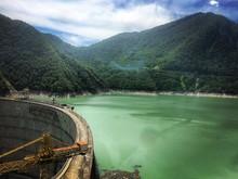 Green Mountains By Enguri Dam Against Sky